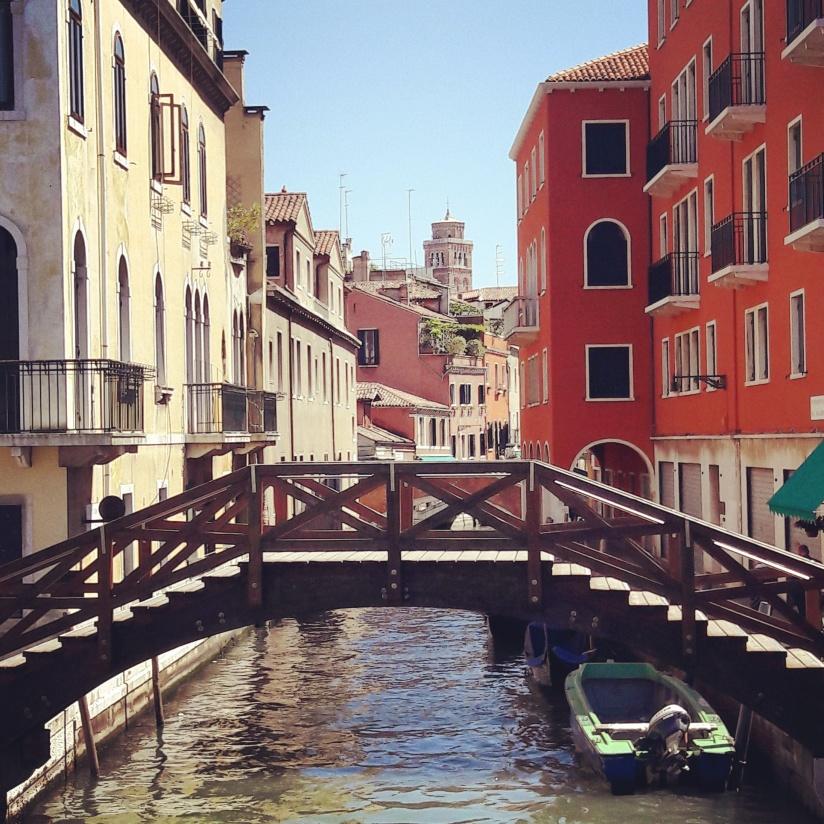 Venice canal boat bridge sunny day