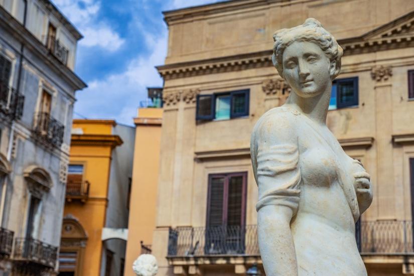 Feminine white stone statue in a Palermo square